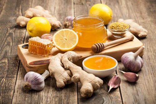 A picture of honey and lemon used in garlic shots